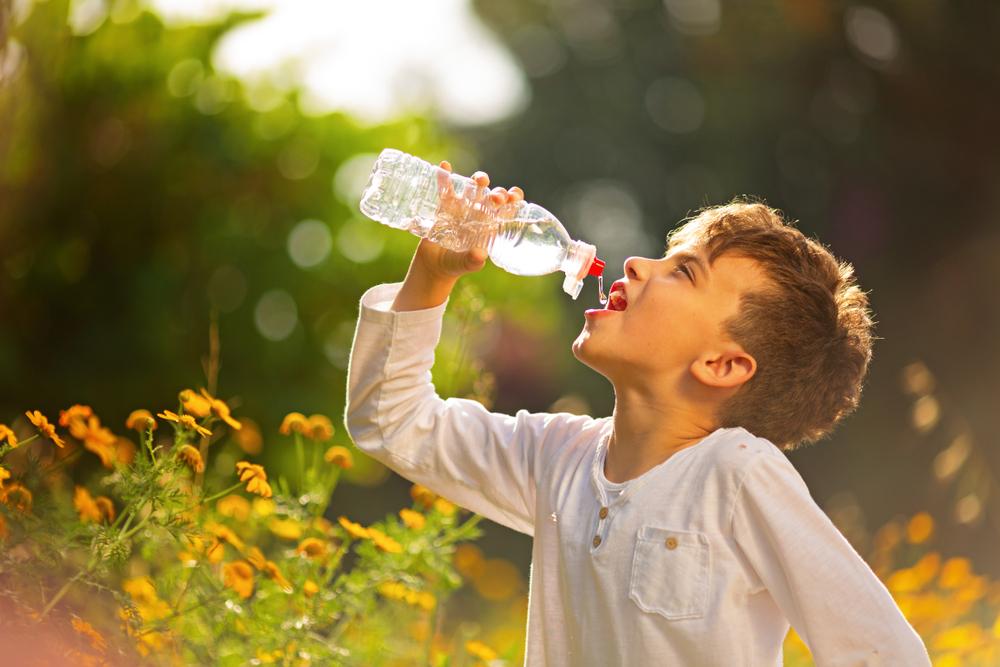 kid drinking water supplements