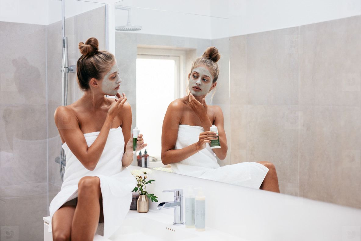 women applying face masks in the bathroom