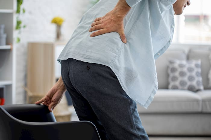 an old man with back pain