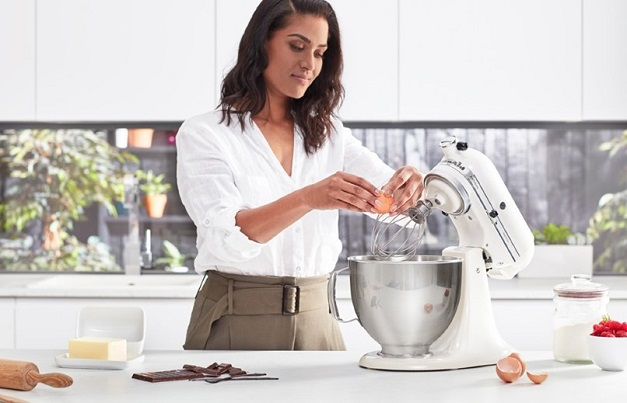 Woman working with mixer in the kitchen