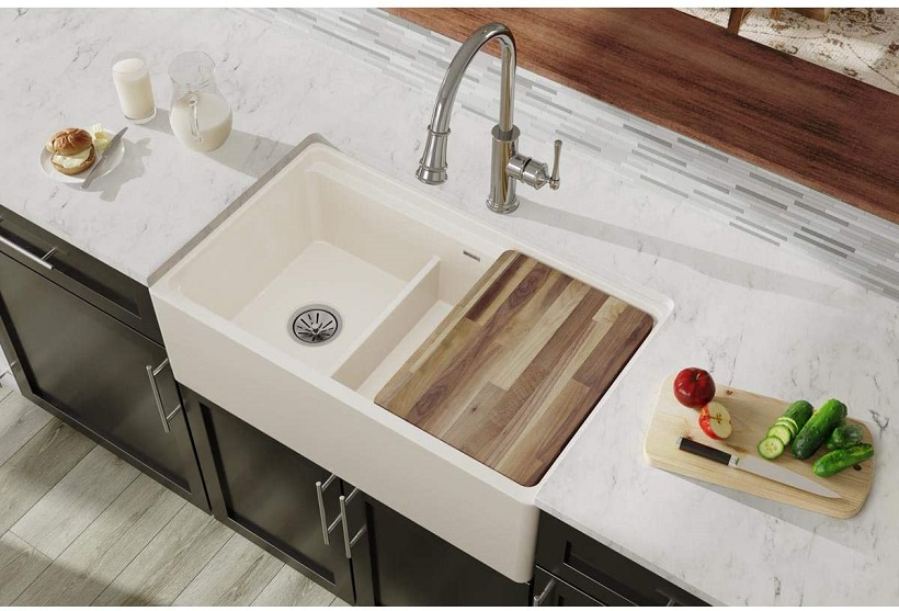 picture of a kitchen sink accessories like chopping board on a granite counter
