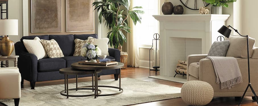 fancy designer seating for living room with black sofa bed wood coffee tables and decorative items