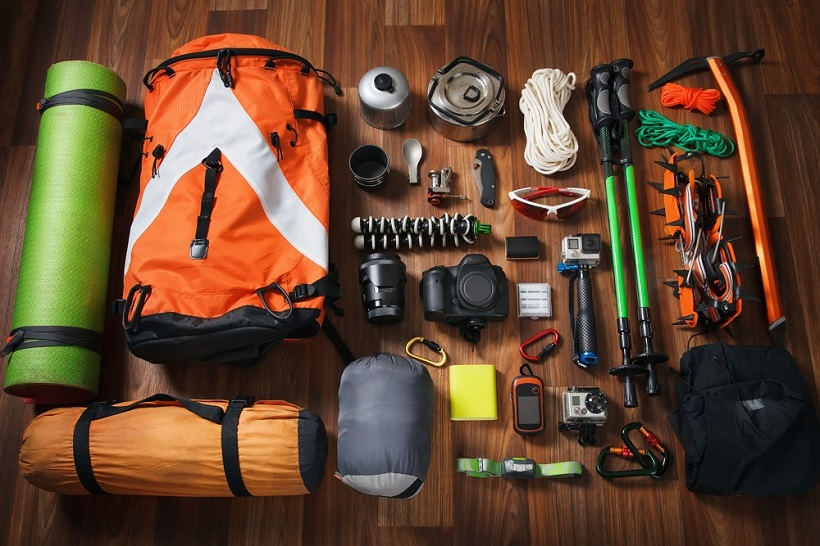 picture of camping essentials on wooden floor