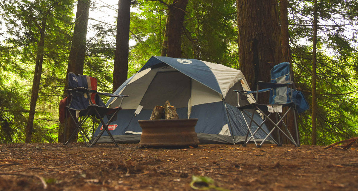 picture of a tent and a camping gear in the mountains