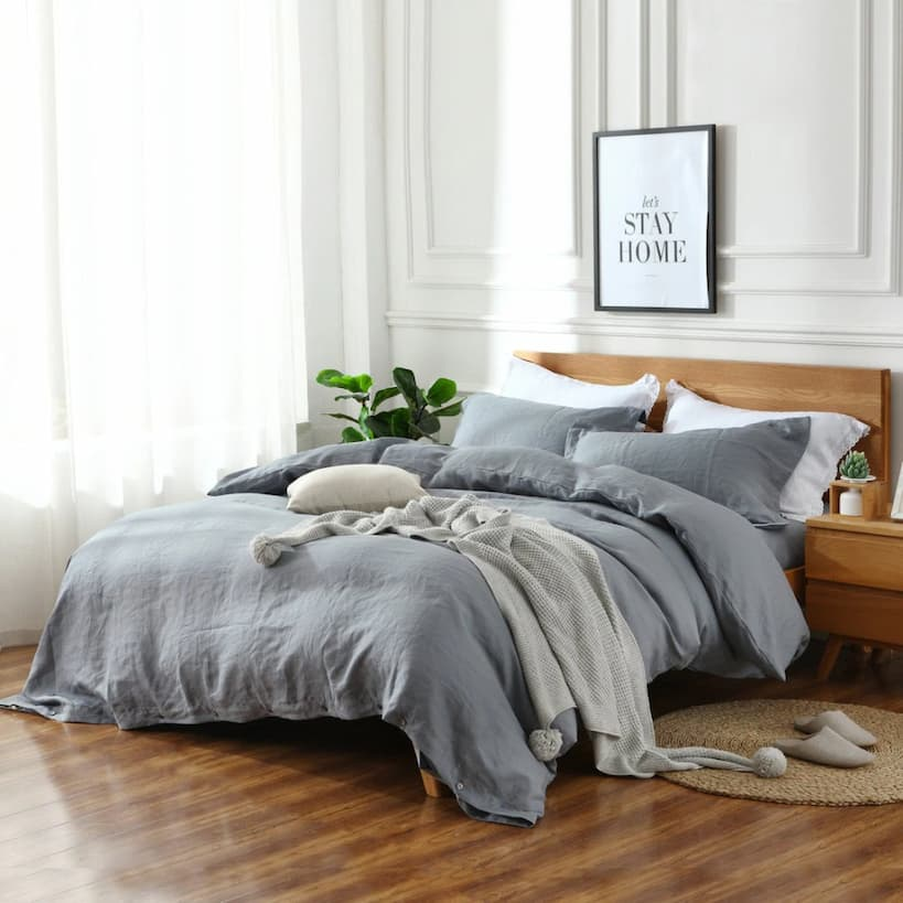 gray linen bedding with decorative throw and pillows