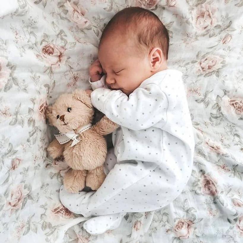 baby sleeping with teddi